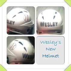 decals on the baseball helmet.