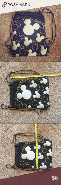 ⭐️Mickey Mouse Drawstring Bag⭐️ Super cute, never used! Silver and gold mouse ears on the front of the black bag. Back is blank. A typical shaped and sized drawstring bag. Disney Bags Backpacks