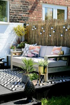 garden patio design with grey sofa and gold accents