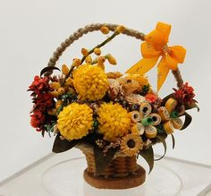 unknown artist - floral arrangement in basket including Gerber daisy, carnation, chrysanthemum, and others