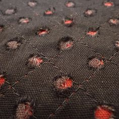 Looks like you pissed someone off and they deliberately burned your couch with cigarettes. [laid couching using red stitches to echo the red underlay fabric - interesting feel]