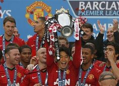 Manchester Uniteds Shinji Kagawa lifts the English Premier League trophy at Old Trafford stadium in Manchester