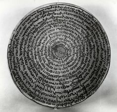 Incantation Bowl  6th-8th Century AD  Late-Post Sasanian   Inscribed in spiral from the centre outwards. Mandaic text. An incantation to protect Shrula son of Duktanuba and Qaqay daughter of Kaspasta against evil spirits.