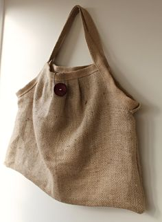 This one of a kind large handbag is handmade from hessian coffee sacks. Its rustic charm is furthered by its eco friendly status. Hessian is a very