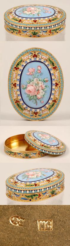 A Russian silver gilt, cloisonne and en plein enamel box, Ivan Saltykov, Moscow, circa 1890. The oval boxdecorated with multi-color scrolling and geometric motifs around a central oval en plein enamel cartouche of pink roses against a pale blue ground within a dark blue band, a border of turquoise enamel beads encircles the lid.