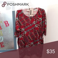 """Irma by Lularoe LuLaRoe's Irma top is a loose, knit """"high-low"""" tunic with fitted mid-length sleeves. The extra length in the back makes it a great compliment to our leggings – especially for all those wanting some extra coverage for their, ahem, assets. Wear this top and you might never take it off. LuLaRoe Tops Tees - Short Sleeve"""