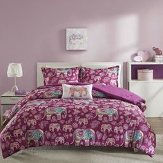 Add a pop of color to your bedroom with the Mi Zone Abby Collection. The rich berry color features a cute paisley design and decorative elephants for a youthful update to your space. One embroidered decorative pillow completes this look.