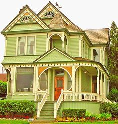 There is something so, so eye-catching cool about this tangerine and lime green hued Victorian house.Would choose different colors for such an amazing house though