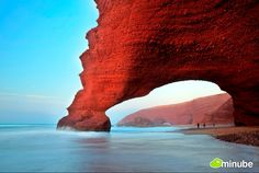Legzira, Morocco - For travelers looking to ditch the touristy resorts of nearby Agadir in search of something wilder, they need not look farther than Legzira, a windswept stretch of coast only a few miles south that's internationally famous for its massive natural archways carved out from the red-rock coastal mountains. (Photo by Zakaria Ait Wakrim)