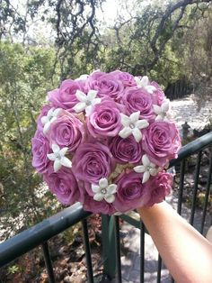 Lavender and white wedding bouquet.  Lavender roses and stephanotis.