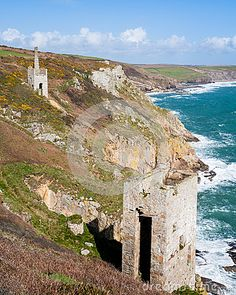 The dramatically located engine houses of Trewavas Head Mine Cornwall, part of the Cornish Mining World Heritage Site.