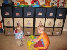 Toy room organization...kids toys in bins labeled with pictures of what's inside!