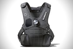 Velomacchi Speedway roll-top backpack for motorcyclists. Magnetic sternum coupler, med pocket and GoPro mount. Details