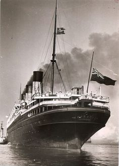 White Star Line MAJESTIC arrives New York following the death of George V with flag at half mast, 1936 via Todd Neitring