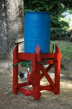 Automatic waterer- pretty much genius. Feed into the barrel with a hose from the roof gutters. Elevation means gravity helps the water flow out. Put the proper gizmo on the end and the animals can water themselves.