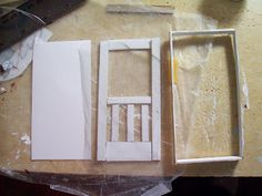 Using tulle to make a screen for a miniature door. Good idea! ;)