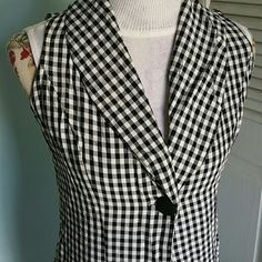 "Vintage Sans Souci Checkered Full length Maxi Vest Black and White unique Vintage Maxi Checkered Vest size S. One button closure on front. In excellent used condition. 100% Rayon. Flat lay measurements are 47"" length / 20"" bust armpit to armpit / 17' waist / 20' hip. Please let me know if you have any questions before purchasing. No lowballs, trades, modeling. 30% discount when using the bundle feature. Vintage Jackets & Coats Vests"