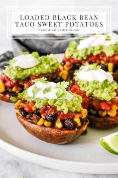 These Loaded Black Bean Taco Sweet Potatoes are covered in seasoned black beans and corn and topped with cheese, sour cream, salsa, guacamole, cilantro, and a squeeze of lime. | Loaded sweet potatoes for a fall Mexican dinner party. | Fall Mexican dinner recipe with sweet potatoes. | Vegetarian dinner recipe for a meatless Monday. | Vegetarian sweet potato tacos loaded with Mexican flavors. | Easy vegetarian Mexican dinner recipe for fall. | Vegetarian recipe for weeknight or weekend meals.