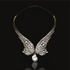 Diamond necklace, 1860s Designed as a pair of wings, set with circular- and rose-cut diamonds, suspending at the front a later baroque cultured pearl drop, fitted case by Gianmaria Buccellati.