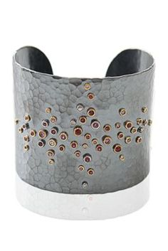 Cuff | Annie Fensterstock. Oxidized sterling silver, 22k gold, Sapphires and Diamonds.