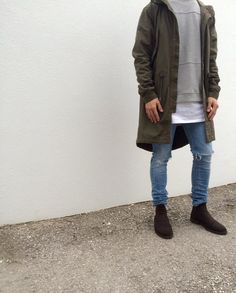 Elongated jacket with layers underneath.