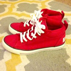Red and white Converse High Tops Women's 8 Red and white Converse high tops. Men's size 6 / Women's size 8. In great condition, minor wear on heels as shown in photos. Converse Shoes Sneakers