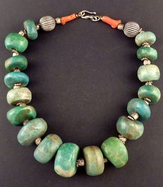 Morocco | Vintage necklace; big amazonite beads, silver and coral beads. Recently restrung. All beads are old with the exception of the two large silver beads at the end | 1'150€