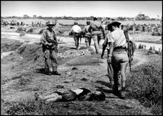 Robert Capa: On the road from Namdinh to Thaibinh. May 25th, 1954. French military patrol.
