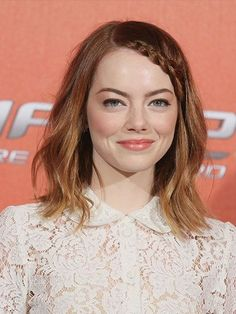 Emma Stone The Amazing Spider-Man 2 red carpet beauty look: braided hairline with peachy cheeks and lips | alure.com