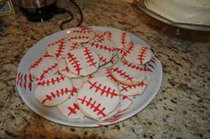 Baseball Cookies that we had at my son's party...these were so easy to make...just sugar cookies decorated like a baseball