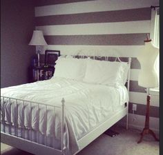 My bedroom! Striped walls, Leirvik white ikea Bed. Still not finished, but proud of the paint job!