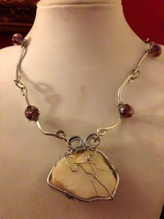 Hammered Silver and Beach Stone Wrapped with Lavender Austrian Crystals by Eldwenne on Etsy https://www.etsy.com/listing/159005506/hammered-silver-and-beach-stone-wrapped