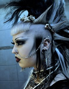 Awesome mohawk with bangs, tendrils... and bones!  (Also with piercings, dramatic makeup, jewelry)