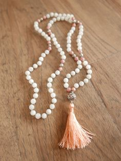 Moonstone and Rhodochrosite enhance the divine feminine within us with an essence of grace and love. This Mala is wonderful for mothers, and those planning for motherhood. It is also beautifully supportive for those hoping to open their heart, embrace their femininity, express grace, and unconditional love.  This Unconditional Love Mala also makes a gorgeous and unique accessory for a bride. What better way to begin your live together than to express your commitment to love unconditionally?…