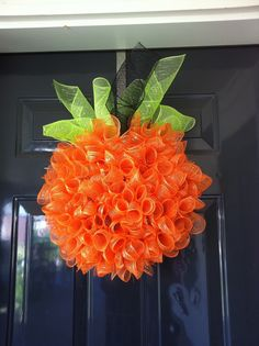 "I am thinking if several holidays I could fashion a frame for......Pumpkin Wreath - What you'll need: two rolls of 4"" orange mesh (found at Hobby Lobby, or this website) one roll of 4"" black mesh for the stem one roll of green 4"" mesh for the leaves large embroidery hoop (however big you want your wreath to be) 2 packages of orange pipe cleaners (and wire cutters to cut them in half)latch hook canvas (found at Hobby Lobby)"