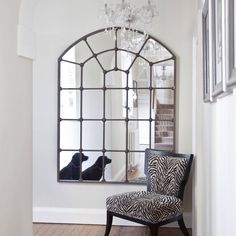 """This metal framed window mirror is truly a large mirror. Creating light and space on a grand scale this will have a huge impact, and give a unique decorative feel to your living area. This large feature would complete any room, enhacing the grand scale of maybe a hall or dining room in the shape or a beautifully arched window. Large metal frame137cm x 180cm (54"""" x 71"""")"""