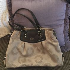 Coach Brown/Tan pocketbook Coach Brown/Tan purse. Some normal wear and tear but still in good condition. Few spots at the bottom. Coach Bags