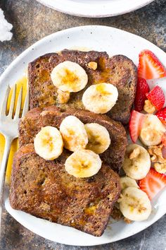 This Banana Bread French Toast is pure paleo breakfast comfort food! Made with a hearty banana-sweetened grain free and paleo banana bread, it's perfect for a weekend breakfast treat when you're craving something indulgent. Gluten free, dairy free, refined-sugar free.