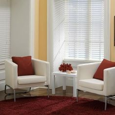 Faux wood blinds give real wood coziness to your biggest spaces, without looking too traditional.