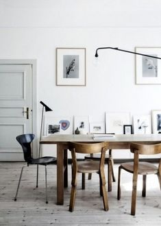 """a black """"Musquito"""" Arne Jacobson chair on the left hand. First picture of this chair on this board."""