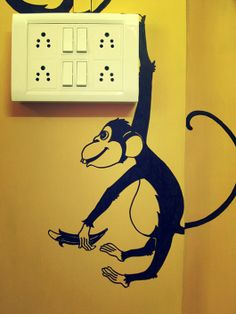 Paint doodles around switchboards. This one has a monkey hanging off it!