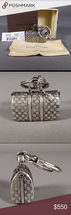 (RARE) Louis Vuitton Keepall Bag Charm/ Key Ring *Ships same or next day*  *Reasonable offers welcome*   - Date Code: EA0136  - Brass w/ Palladium finish  - Comes w/ box, dust bag, and tag like when new - Damier Pattern with luggage tag, handle holder, zipper, Lock and Key  - Exception Detail!  - Looks great with a nice sheen, but may be polished if desired to brighten it further - Ring and clip work properly Louis Vuitton Other