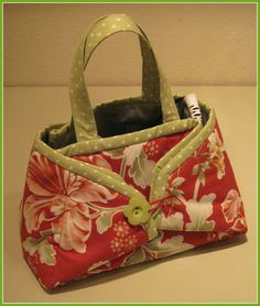 Iron Tote. opens to be a pressing mat Great to take to sewing classes. Click the picture for the link to make it. Be sure to use the proper batting.I used a pony tail band to loop over the button