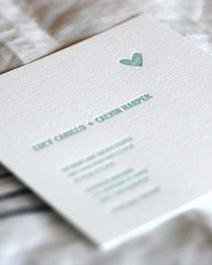"Minimalist Invitation    A single heart motif is a hip way to say ""romance.""    Satsuma Press"
