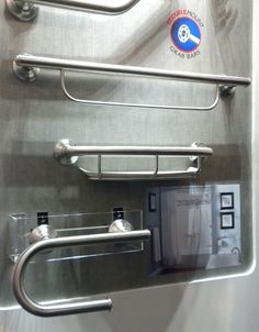 """Universal design was a buzz word at the show. <a href=""""http://www.moen.com/"""">Moen</a>'s grab bars were unique in that they incorporated other bathroom elements, such as a towel rack (top), shower caddy (middle), and toilet paper holder (bottom)."""