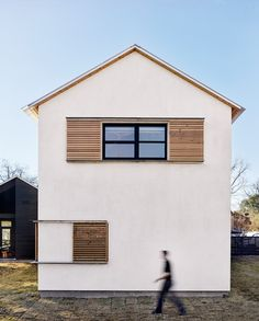 Lakefront Austin home by Aamodt Plumb Architects is a building of two halves.