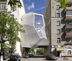 Photo credits: Architonic    Rather than compete for space, the Parasite Office is designed to leach off of existing alleys and gaps between buildings. Russian practice Za Bor Architects conceived of the idea of a hanging, multifunctional, and organic-looking structure that makes use of Moscow's tight spaces without interrupting the flow of street movement.