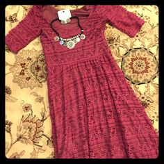 Lace Dress XS super cute!! Size XS Lace Dress by Xhileration dress has belt loop but does not include a belt.  I suggest cute cowboy studded belt to complete the look. Does have a slight hi lo effect about 3-4 inch longer in back. Xhilaration Dresses