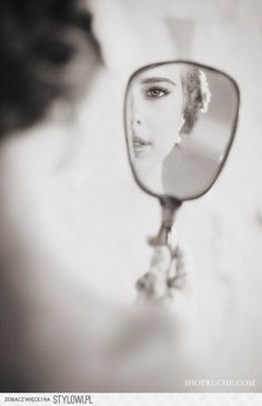 A gorgeous bride in stunning bridal makeup getting ready on her wedding day, through the mirror. Discover how Vênsette can craft custom beauty looks for your special moment: http://vensette.com/bridal_inquiries