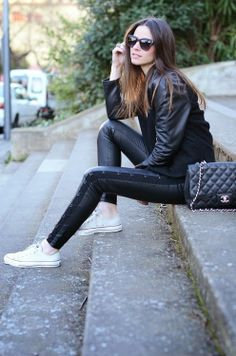 Black blouse with shining black leather jacket and black stylish casual jeans and black leather hand bag and white shoes the perfect outfits...